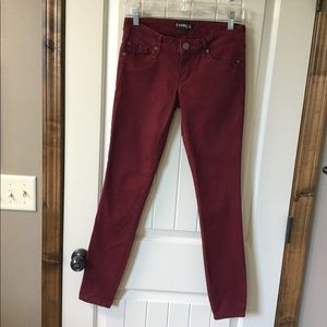 Express plum colored skinny jeans